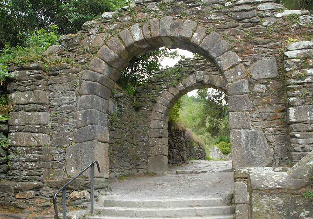 Stone arches on path in the woods